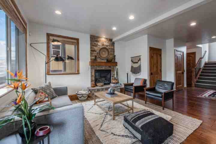 The living room and gourmet kitchen is the center of the home; it's equipped with comfortable furnishings, fireplace and access to your balcony. - Still Water Mountain View Townhome - Heber City - rentals