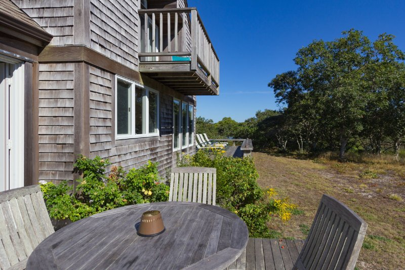 Outdoor Dinind area, and Sunny Deck beyond. - NAKAJ - Waterfront and View on Edgartown Great Pond, Association Private Beach - Edgartown - rentals