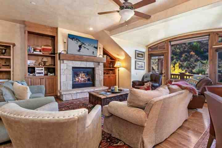 "Warm living space with full size sofa sleeper, stereo, 60"" flat screen TV/Blu Ray DVD, gas fireplace and deck with gas grill and seating for 2. - Arrowhead Alpine Club Condo, YR Rnd Hot Tub & Heated Pool, AC in Summer, Ski In/Ski Out in Winter! - Edwards - rentals"