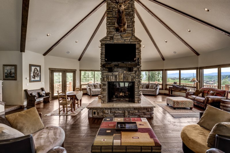 The great room..  20 foot ceiling and two sided fire place. - Massive Steamboat Ski House, Views, 2 hot tubs - Steamboat Springs - rentals
