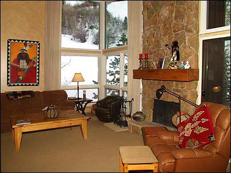 Living room with stone fireplace and view of slopes - Aspen Ski-in/Ski-out - Steps to Lift 1-A (4346) - Aspen - rentals