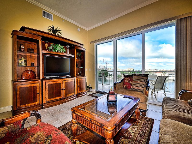 Living room has a flat screen TV and access to the balcony. - Bay Harbor 504 Waterfront | 3 bedrooms, 3 baths. Just over 1800 square feet - Clearwater Beach - rentals