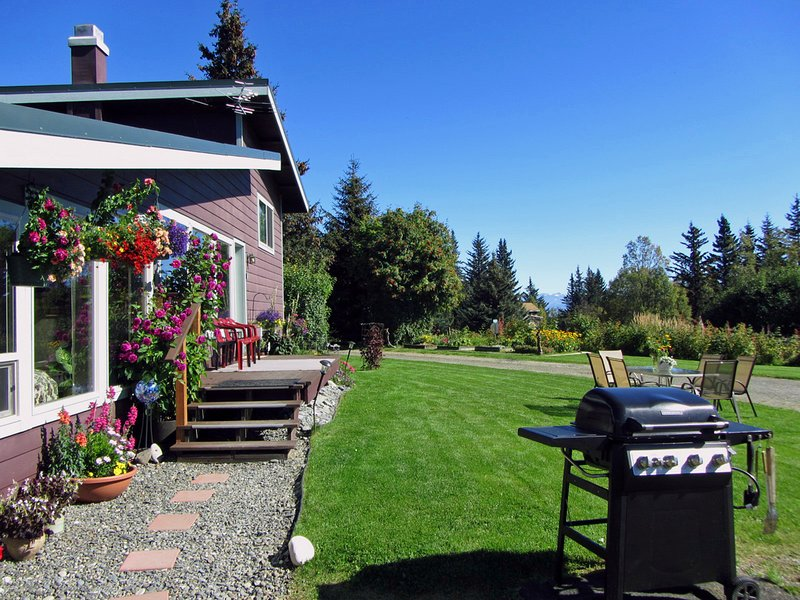 Front of house with outside dining and grill. More outside dining furniture and seating available. - Above the Bay - Homer - rentals