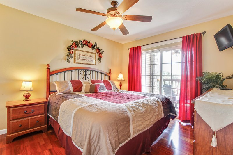 Master bedroom with King pillow top mattress, has access to deck - Beautiful 2br*Memory Maker (24-4)*Condos~Silver $ City~ INDOOR POOL-Branson-Lake - Indian Point - rentals