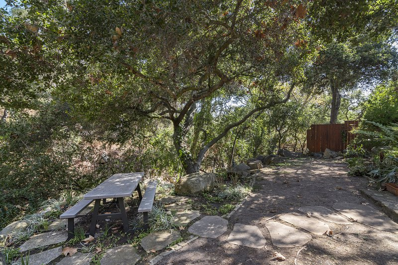 The sanctuary like atmosphere in the back of the house will instantly relax you while you eat the picnic table. - Custom creekside home in beautiful natural setting - Creekside Haven - Santa Barbara - rentals