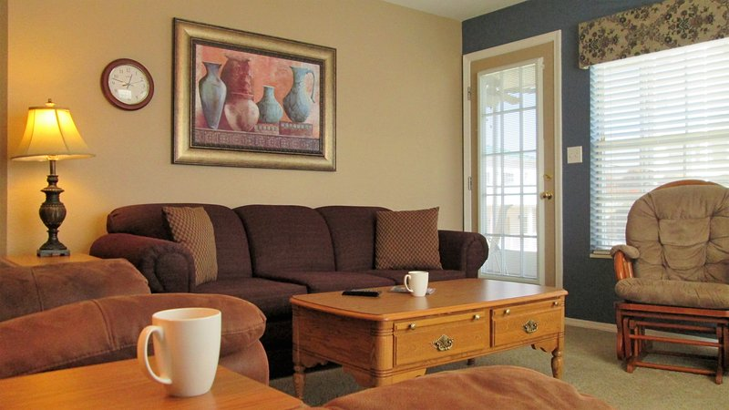 Book now.  The living room has a queen sized sofa sleeper. The door exits to your own screen porch.  - Brookside Walk In, Recliners! |Meadow Brook Resort - Branson - rentals