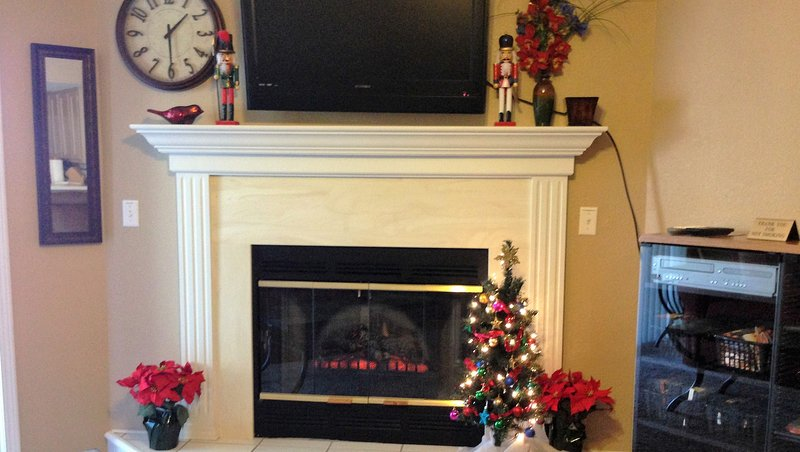 The fireplace decked out for an Ozark Mountain Christmas.  - Screen Porch View-Recliners-4 Steps |Pointe Royale - Branson - rentals