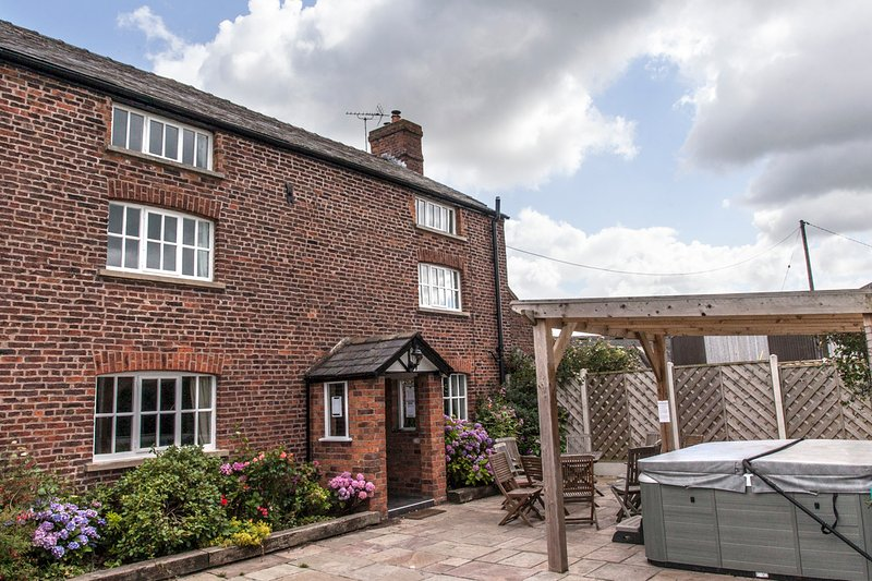 7 bedroom farmhouse patio area with Pergola covered hot tub, ideal for anytime of year. - Cheshire Country Holidays - Congleton - rentals