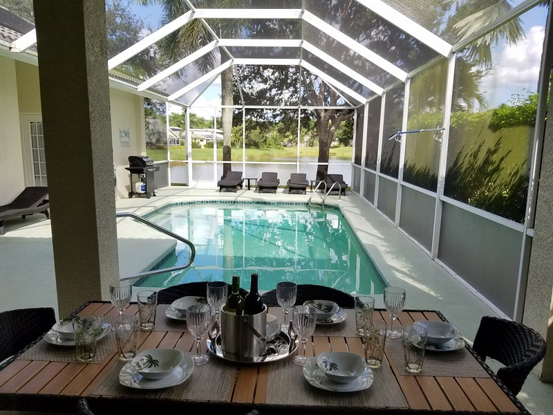 MODERN 4 BEDROOM VILLA WITH LONG SUNSETS LAKE VIEWS CLOSE TO BEACHES & DOWNTOWN - Image 1 - Naples - rentals