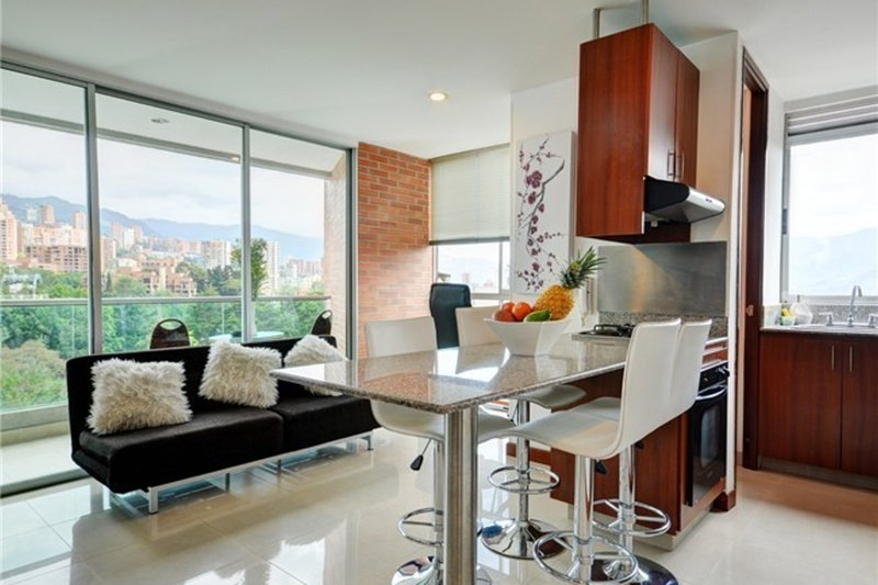Enjoy the beautiful view while eating breakfast, lunch or dinner. - Modern Comfortable Condo with Pool - Medellin - rentals