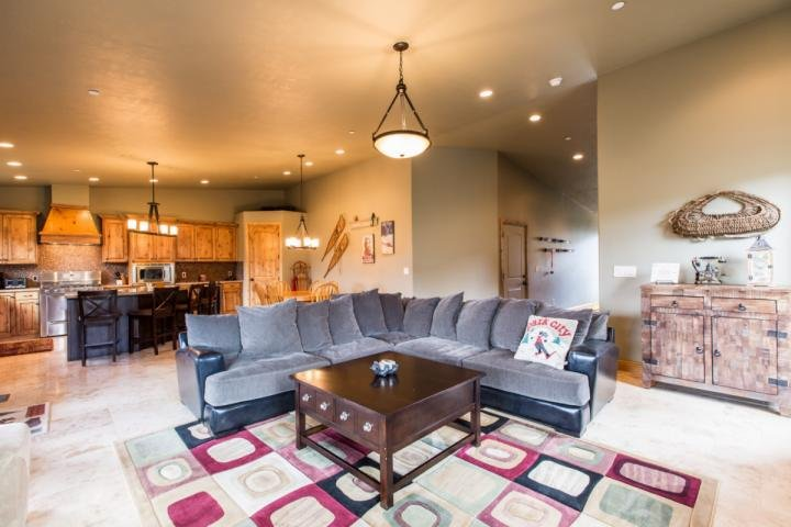 "The living / family room features a large and plush L-shaped couch, river rock fireplace and a 55"" HDTV. This home is a fantastic place for anyone vis - Still Water 4 Bedroom Jordanelle Townhouse - Heber City - rentals"