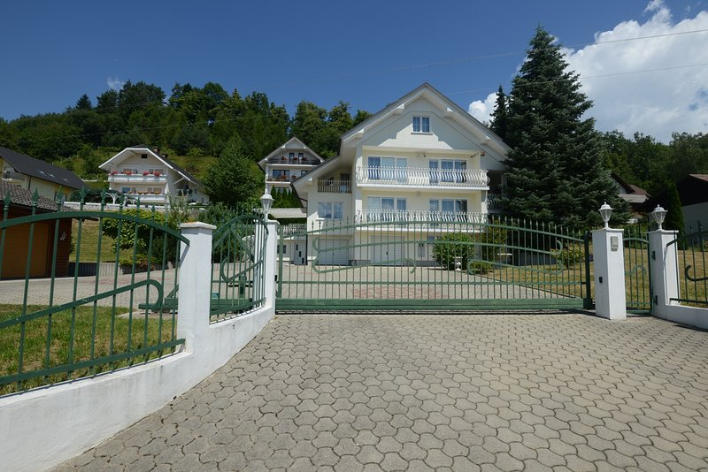 The electric gate provides privacy and security for a care-free vacation - Spacious Villa with Private Garden near Lake Bled - Ljubljana - rentals