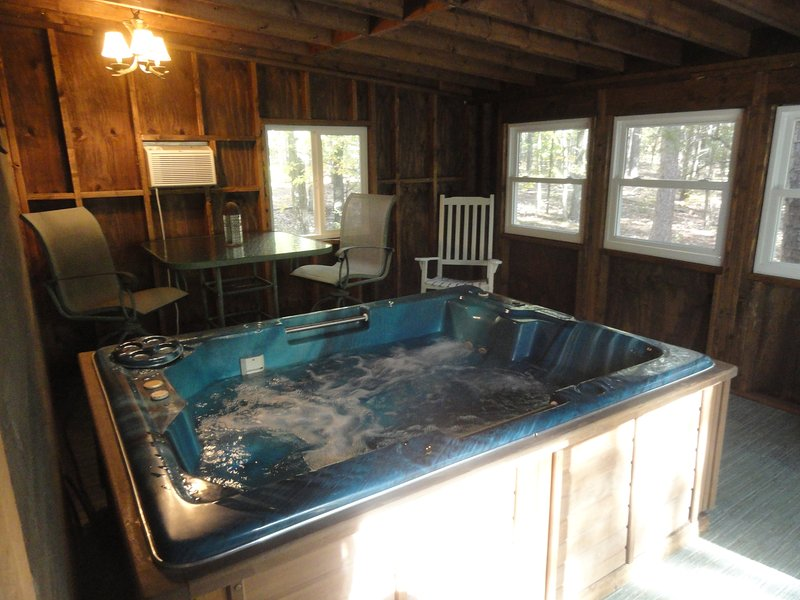 Hot Tub in enclosed back porch overlooking over an acre of woods - Greers Ferry  Indoor HOT TUB, walk to lake - Greers Ferry - rentals