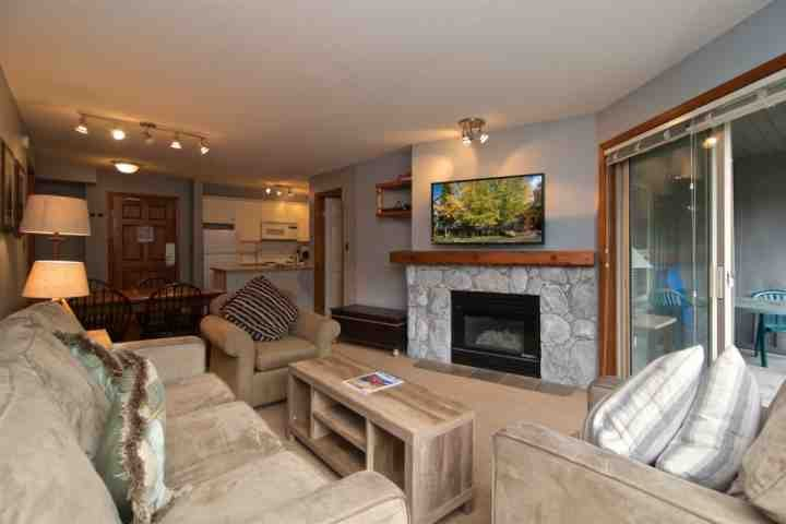 Lovely and bright living area. Gas fireplace and new big screen TV - The Aspens 2 bed/ 2 bath unit 232 - Whistler - rentals