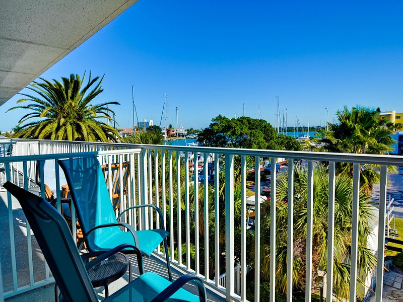 Balcony overlooks the pool with the harbor also visible - Bayside Condos 23 Bay View Condo - Clearwater Beach - rentals