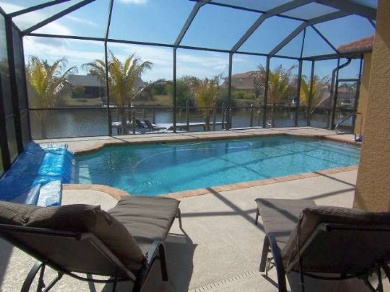 Tropical Oasis - SW Cape Coral 3b/2ba Elect Heated Pool, Gulf Access Canal, HSW Internet , Boat Dock with Tiki Hut, - Image 1 - Cape Coral - rentals