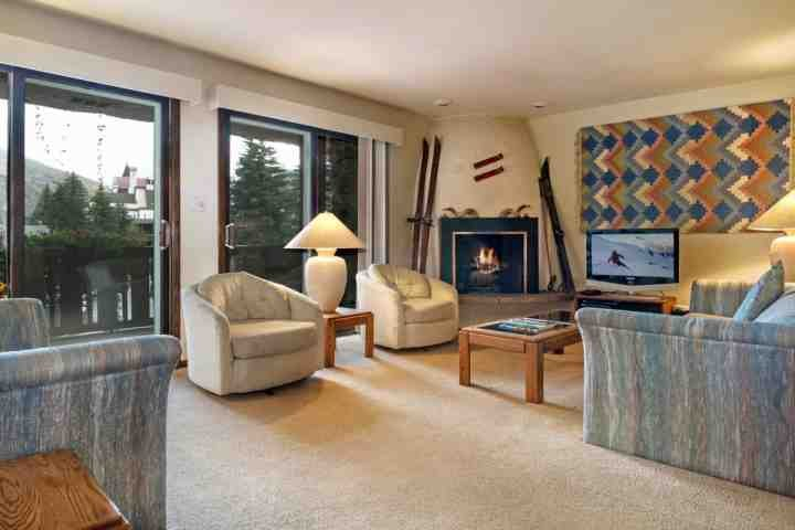 "Spacious living room with 31"" flat screen TV/DVD and wood burning fireplace. - Deep Discounts for Nearby Daytime Noise Construction! Convenient Location, Access to Pool & Hot Tub! - Vail - rentals"