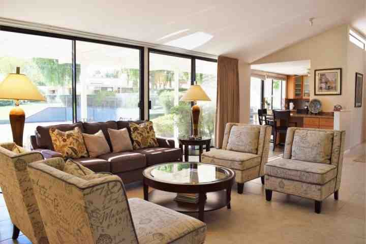 Living room opens to kitchen and dining areas - Great location in Dorado Villas!  Elegant 3/3 Condo, Spectacular South Mtn. View, Pool, Spa & Tennis - Indian Wells - rentals