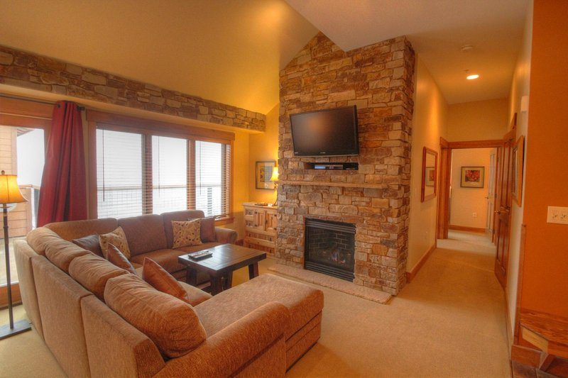 """SkyRun Property - """"8912 The Springs"""" - Living room - Large sectional sofa, that also has a queen sleeper sofa. - 8912 The Springs - Keystone - rentals"""