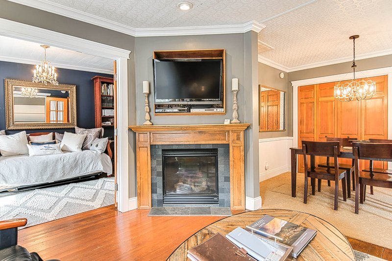 TV with Tivo andHBO over fireplace in living rm w/ library to the left and dining room to the right. - Luxury Boutique Cottage | Hot Tub*Wifi * Fireplace - Park City - rentals