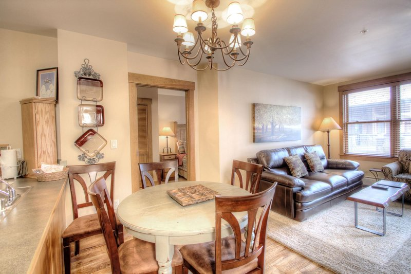 """SkyRun Property - """"8824 The Springs"""" - Living area from Kitchen - The windows provide light and view for the whole condo.  Even the 'chef' can look out through the aspen trees to be inspired. - 8824 The Springs - Keystone - rentals"""