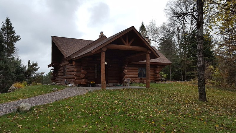 PET FRIENDLY  LOG HOME, ON 2 PRIVATE, WOODED ACRES - Image 1 - Star Lake - rentals