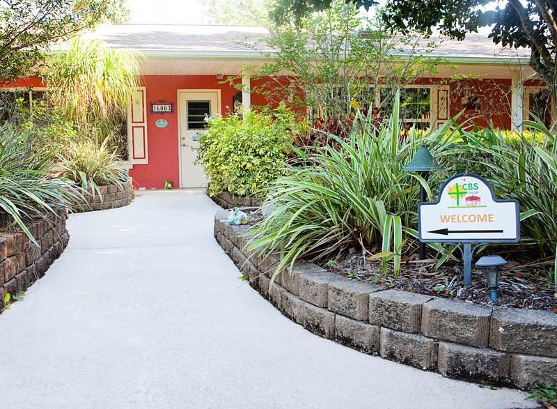 Walkway from covered parking to Inn. - CBS POP INN  (Short term furnished rental) - Bradenton - rentals