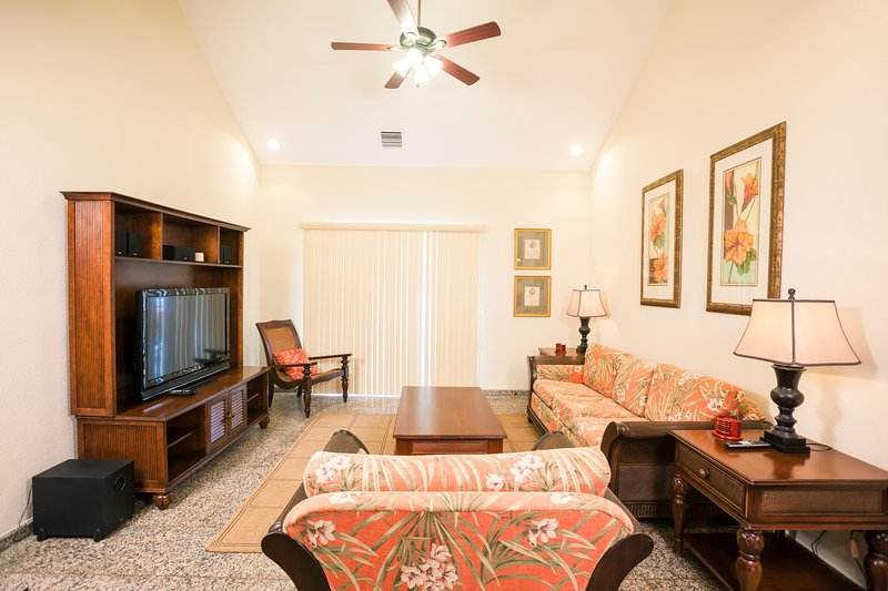 The living area has cable TV and sound system - Lawson Rock - Yellowfish 210 - Roatan - rentals