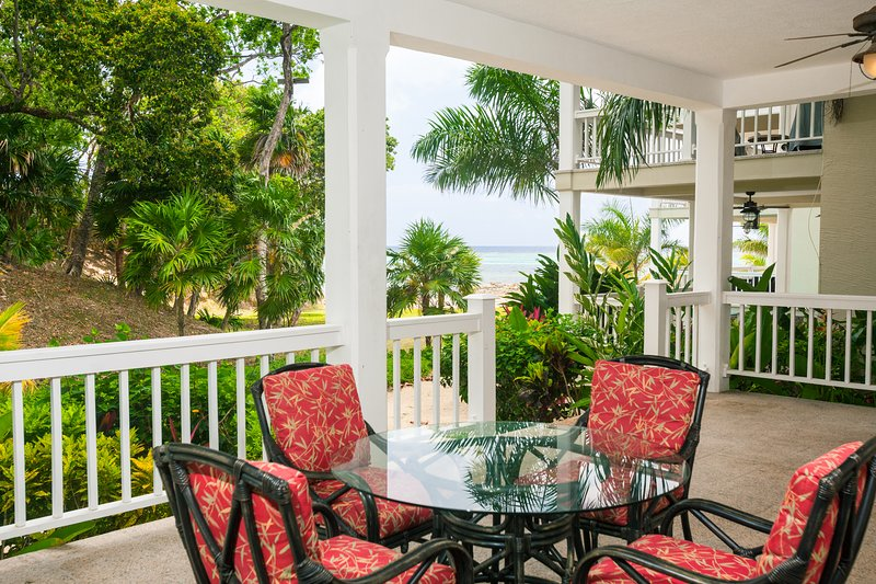 Enjoy the private patio with steps to the sea - Lawson Rock - Parrotfish 106 - Roatan - rentals