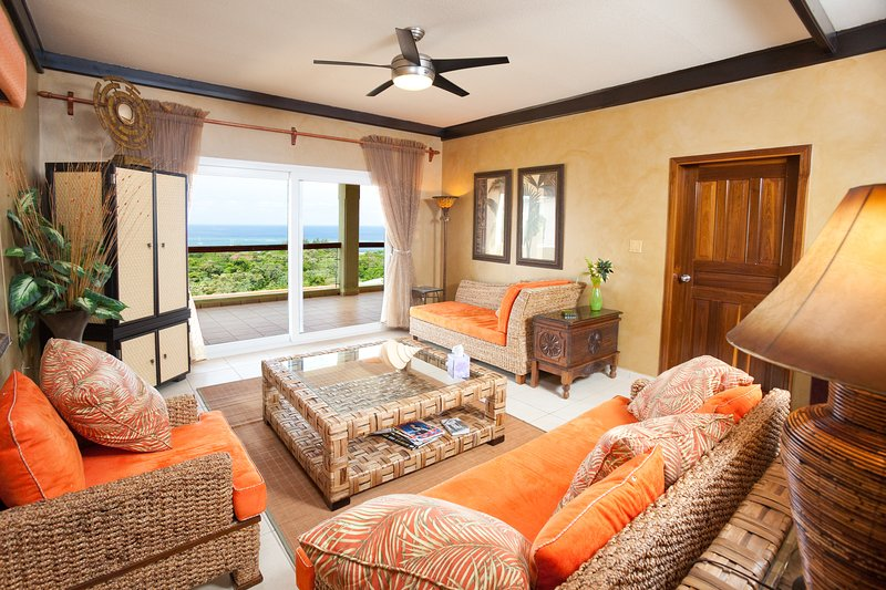 Comfy living room with ocean view - Views of Sunset Estates 3B - West End - rentals