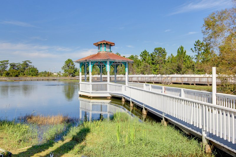 Take a stroll and walk out to the dock to enjoy the view. - Dockside (4374 B) - Orange Beach - rentals