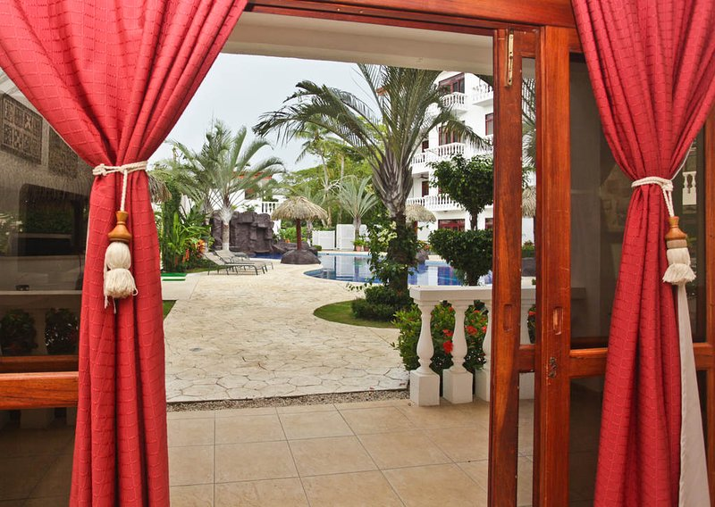 Sliding doors that lead to a private outdoor dining patio overlooking the pool - Paloma Blanca 1I 1st Floor Pool View - Jaco - rentals
