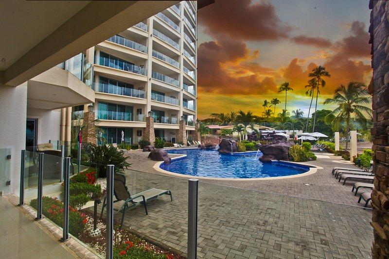 Pool view from balcony - Diamante del Sol 103N 1st Floor Ocean View - Jaco - rentals