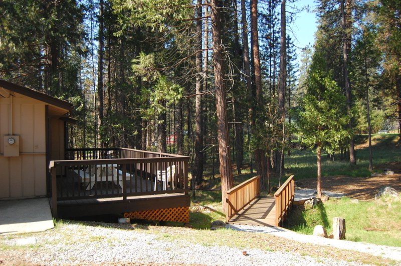 View of back deck and foot bridge over seasonal stream opening up into the natural wedding site - (17C) New Beginnings - Wawona - rentals