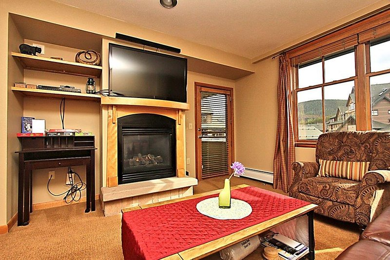 Get warm and snuggly next to the fireplace. - Zephyr Mountain Lodge 1504 - Winter Park - rentals