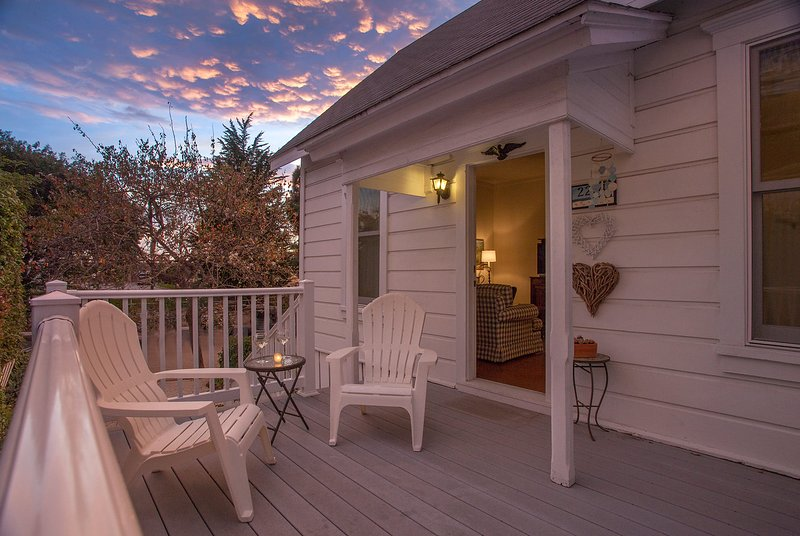 Enjoy the evening sunset on the front porch - Summerland Stagecoach Cottage - Summerland - rentals