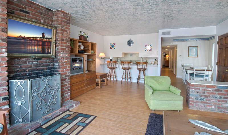 Interior picture showing fireplace, family room and bar countertop to kitchen - 1819 A W. Balboa - Newport Beach - rentals
