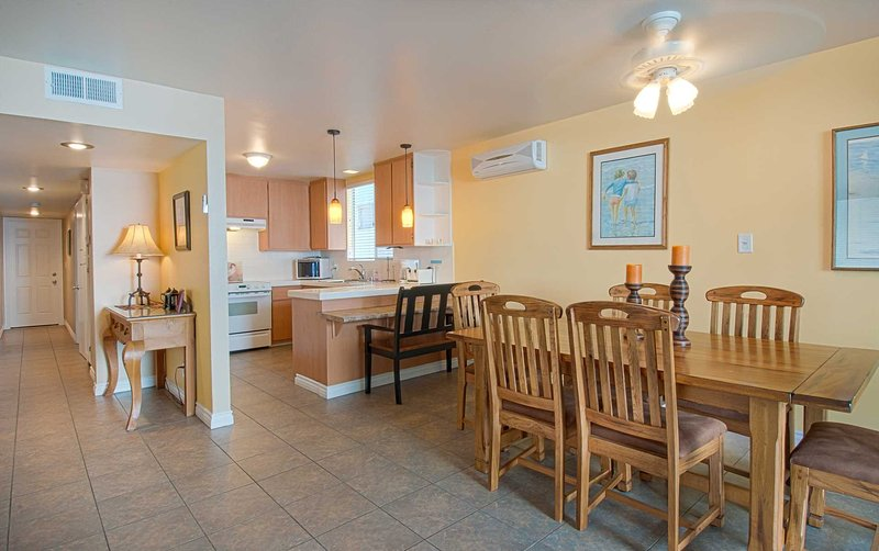 Inside picture showing kitchen and dining area - 5206 A Neptune - Newport Beach - rentals