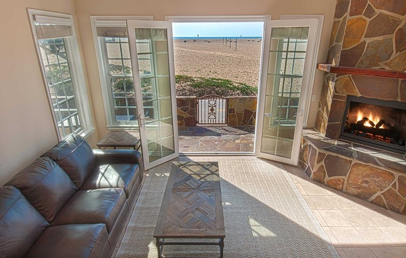 Photo showing view to the beach from the living room area - 408 A E. Oceanfront - Newport Beach - rentals