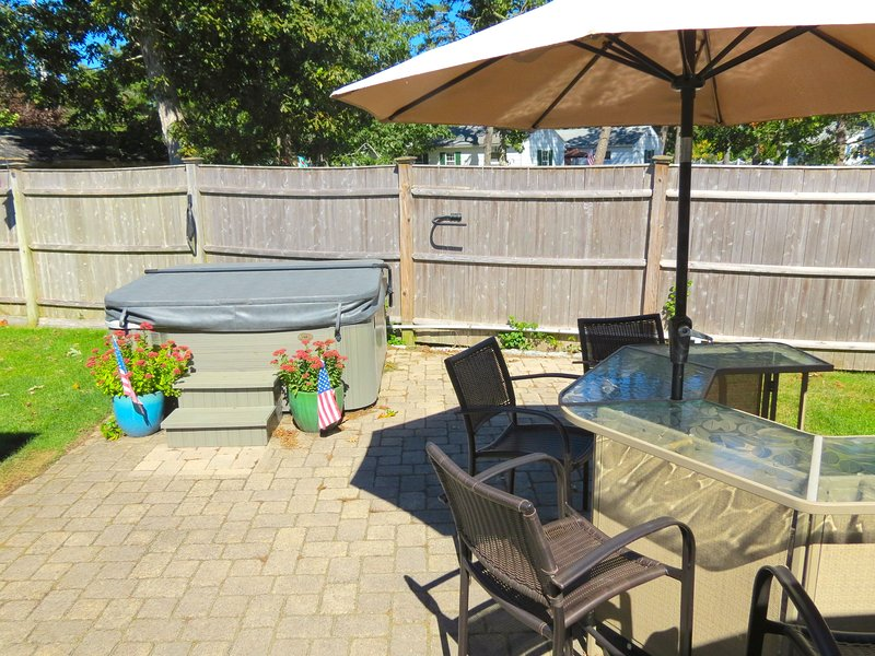 Enjoy outdoor living at its best with a spa tub, umbrella bar, gas grill and enclosed outdoor shower. - Outdoor Living Space to Spare, Walk to Beach:082-H - West Harwich - rentals