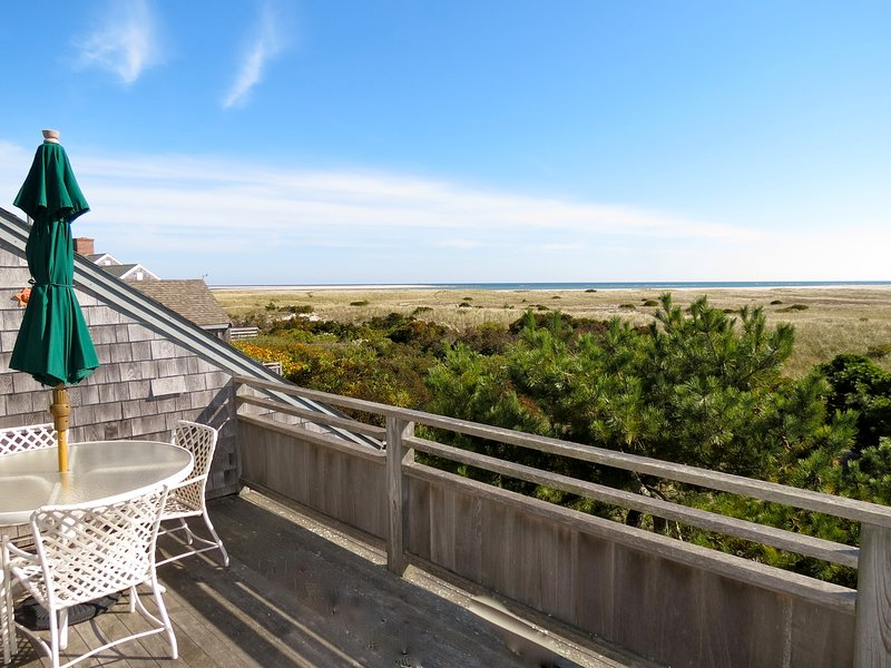 Expansive views of the Atlantic from this ideally situated Chatham home. That's the southern end of Chatham's Lighthouse Beach right out there. It's about an eight-minute walk to the beach. - Water Views Near Chatham Light, sleeps 11; 036-C - Chatham - rentals