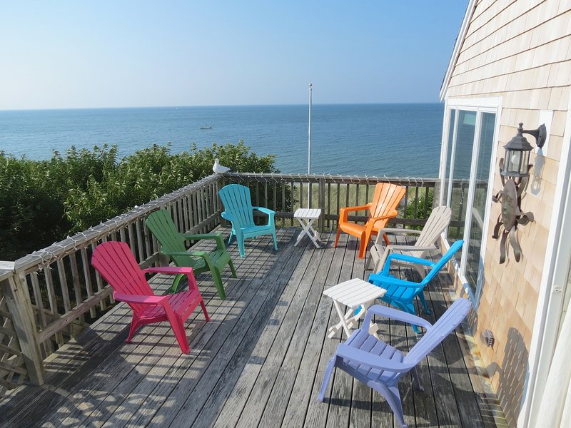 Sweeping beach and bay views from the west deck of this ideally situated family beach house.  Five bedrooms offer flexible sleeping arrangements for groups up to eight. - Breathtaking Views Directly On Sandy Beach--117-B - Brewster - rentals