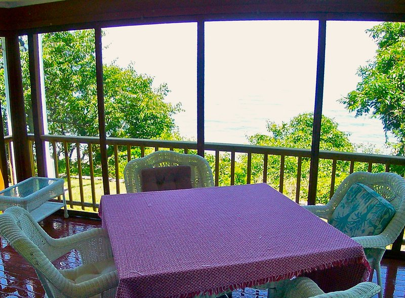 The screened porch overlooking the beach and bay provides stunning views for breakfast, lunch and dinner. - Perfect Perch on Private Brewster Beach -- 116-B - Brewster - rentals
