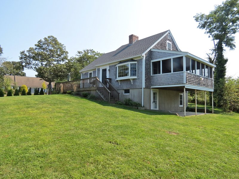 Vacation house features a wrap-around deck and a four-minute walk to a private, sandy, neighborhood beach. - Nice & Roomy, 4-Minute Walk to Sandy Beach--055-B - Brewster - rentals