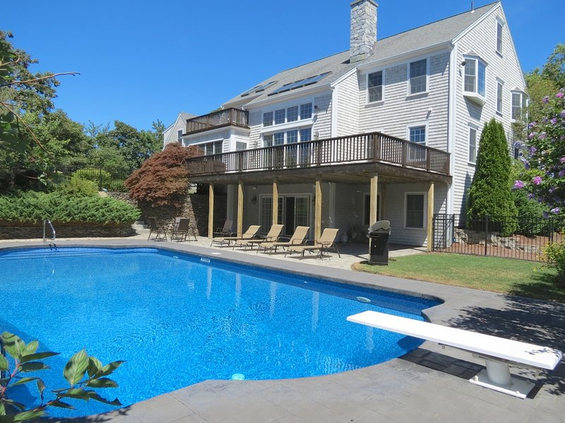 The in-ground 20' x40' pool is the focus of the exterior space - Spacious Modern Home with huge pool! : 011-Y - Yarmouth Port - rentals