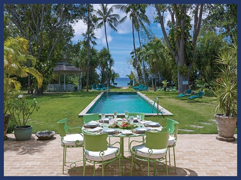 Located on a half mile of pristine, sandy beach this luxury Villa is an idyllic getaway. Swimming pool and outdoor dining - Image 1 - Mullins Beach - rentals