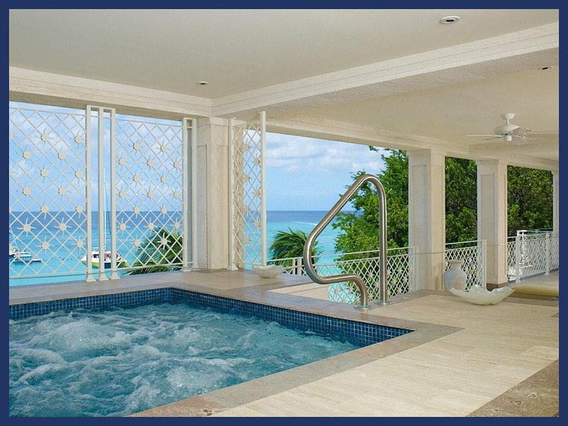 Creatively and vibrantly designed luxurious apartment is located on one of the most desirable beaches on island - Image 1 - Paynes Bay - rentals