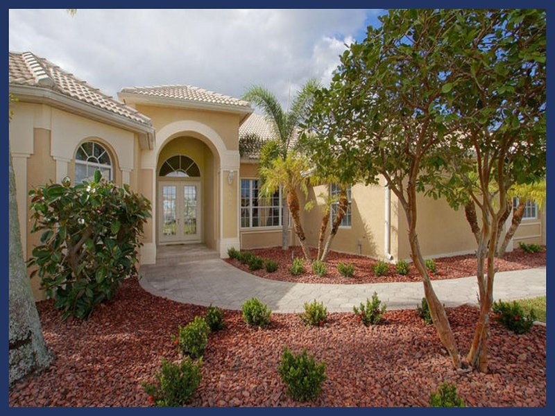 Peaceful & classy- 3 bedroom luxury waterfront villa- Gorgeous Gardens- Pet Friendly- Large pool - Image 1 - Cape Coral - rentals