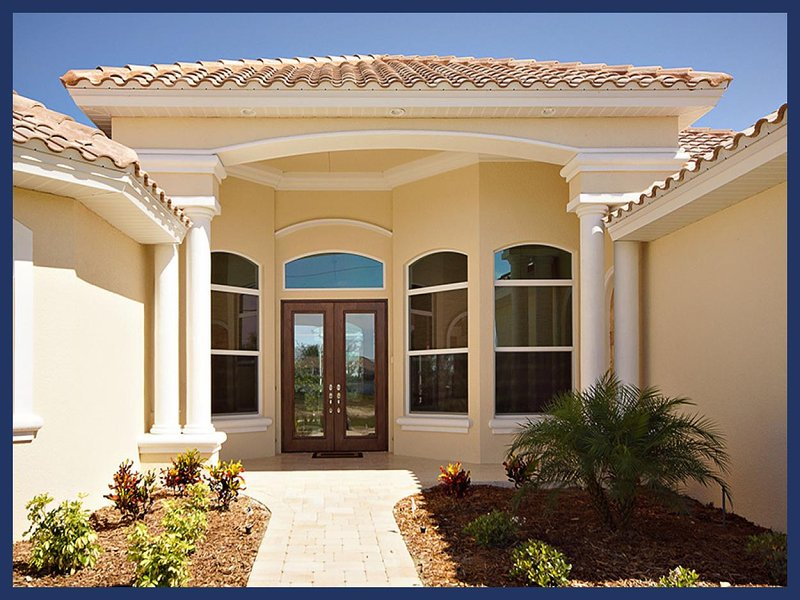Single family, lovely vacation rental- Summer kitchen- Large pool- Lake views- 4 bedroom home - Image 1 - Cape Coral - rentals