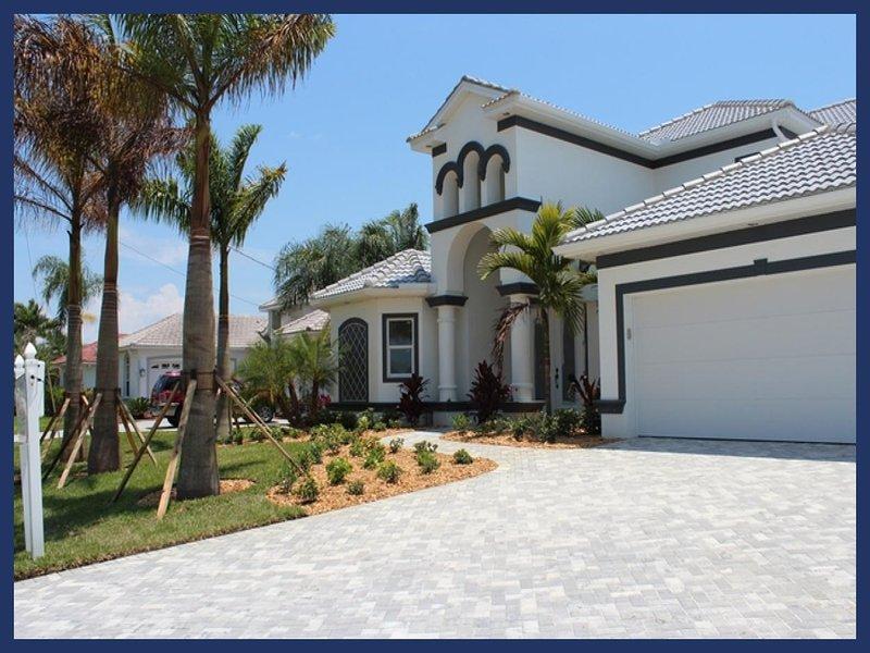 2013 completed beautiful Villa-Illuminated pool-Luxury furnishings-Bar-Boating dock-5 bedrooms - Image 1 - Saint James City - rentals